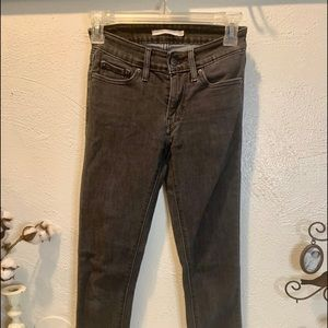 Levi's 711 skinny jeans and a black wash